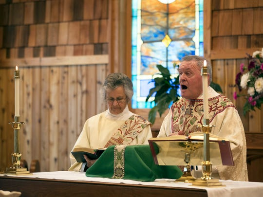 Rev. Elizabeth Ohlson, Deacon, and Rev. Douglas Eberly conduct service. Sandy memorial Mass at the rebuilt St. Elisabeth's Chapel in Ortley Beach, which was supposed to  be followed by a ceremony on the beach at the site where Sandy did some of the worst damage on the Shore. The beach ceremony was cancelled due to the nor'easter that hit on the Fifth Anniversary of Superstorm Sandy. Short speeches were done after the service in the church instead. Some parishioner came in Halloween costume because of the upcoming holiday.