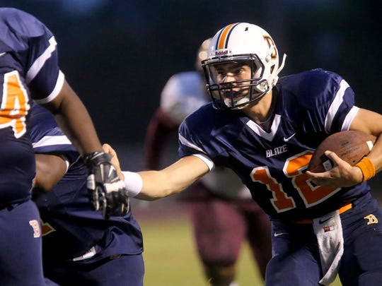 Blackman quarterback Miller Armstrong (12) runs in his first touchdown of the night against Tucker at Blackman, on Friday Sept. 11, 2015.