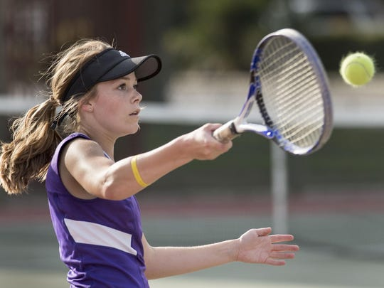 Mission Oak's Lindsay Swall returns to Tulare Union's Prisha Kamboj in the No.2 girls singles match. Swall won the match 6-4, 7-5.