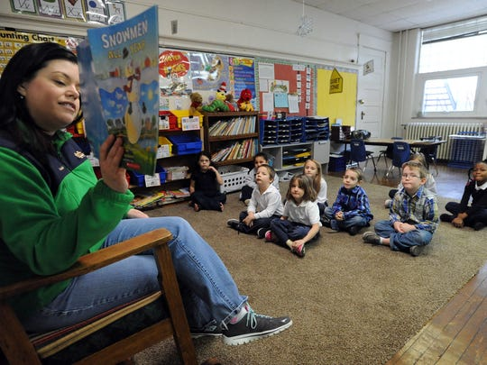 Marion's St. Mary Elementary School's kindergarten teacher Emily Crabtree reads to her students Friday. Roughly 40 percent of the school's students use state vouchers.