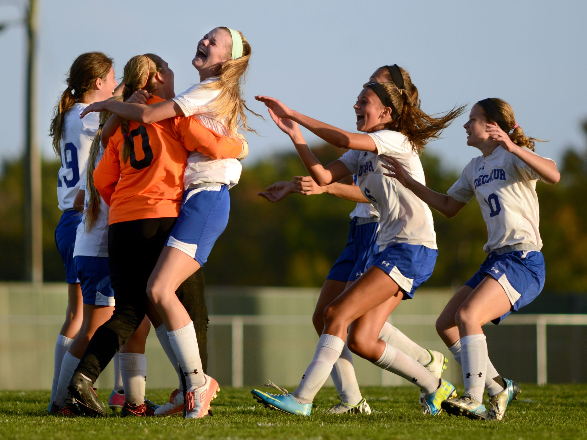 Members of the Stephen Decatur soccer team celebrate their defeat over Parkside Tuesday afternoon in Berlin.