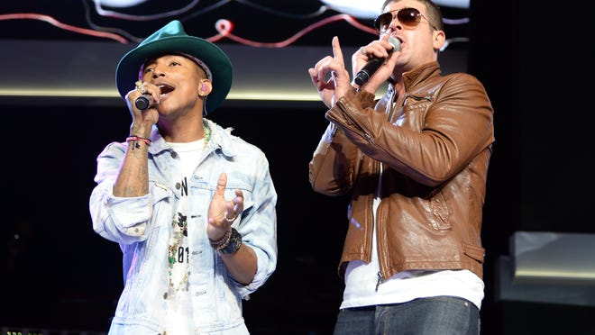 Pharrell Williams, left, and Robin Thicke