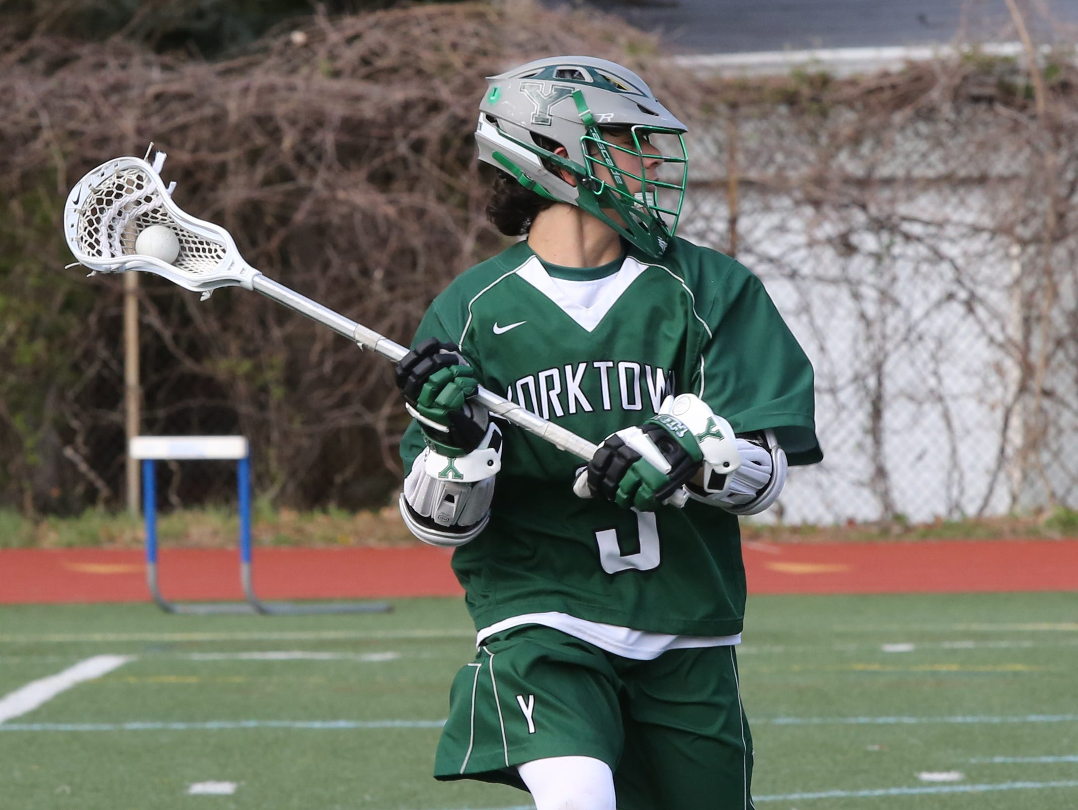 Yorktown's Jamison Embry looks for an open player during game the Huskers' victory over Bronxville at Bronxville High School on Thursday. Embry had four assists as Yorktown defeated the Broncos 9-5.