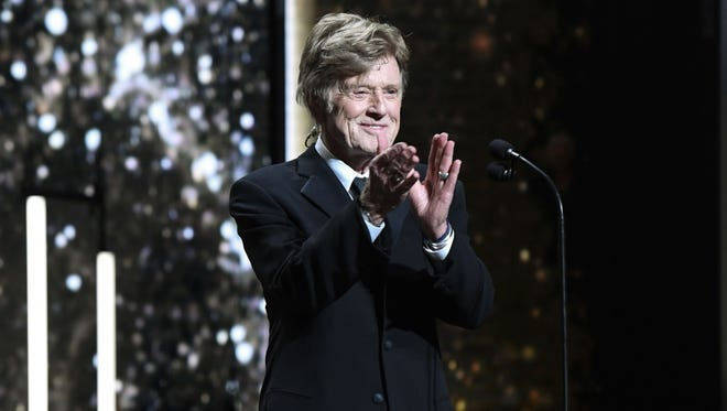 Actor and director Robert Redford applauds on stage of the 44th edition of the Cesar Film Awards ceremony at the Salle Pleyel in Paris.