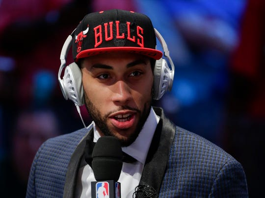 Denzel Valentine answers questions during an interview after being selected 14th overall by the Chicago Bulls during the NBA basketball draft, Thursday, June 23, 2016, in New York.