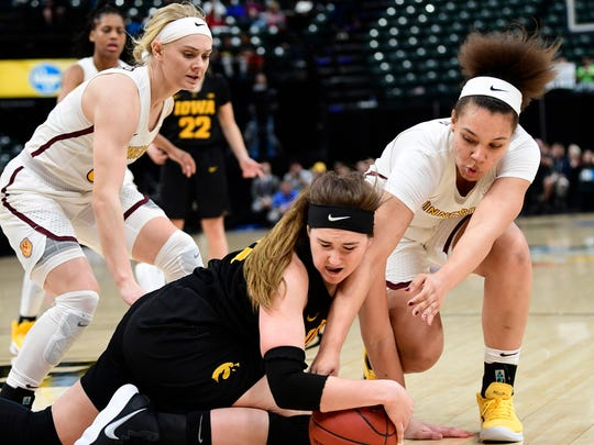 Mar 2, 2018; Indianapolis, IN, USA; Iowa Hawkeyes forward Megan Gustafson (10) dives to recover a loose ball against Minnesota Golden Gophers guard/forward Destiny Pitts (3) in the second half during the third round of the Big Ten Conference Tournament at Bankers Life Fieldhouse.  Minnesota defeated Iowa 90 to 89.  Mandatory Credit: Marc Lebryk-USA TODAY Sports