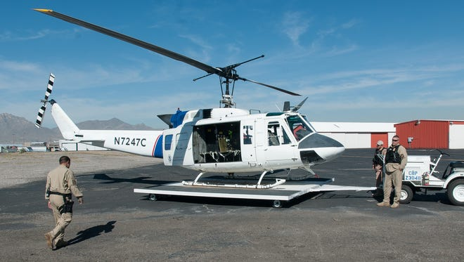 Pictured is a U.S Customs and Border Protection UH-1 Huey helicopter.