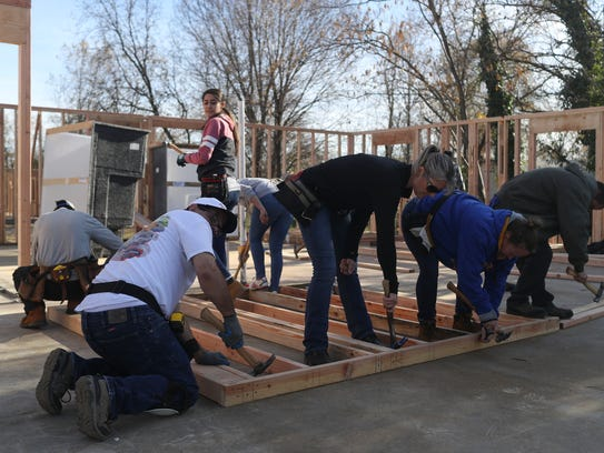 Roxi Mueller, center, works with neighbors Saturday
