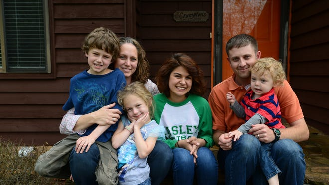 Charlie and Jessica Crumpton recently adopted their foster daughter Amanda, 18, center.