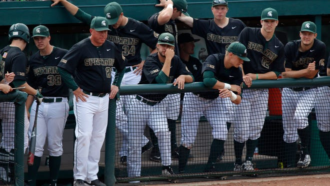 Michigan State players and coach Jake Boss, third from left, react as Nebraska gets the final MSU out of the game to get a 6-3 win Saturday, May 7, 2016, in East Lansing, Mich.