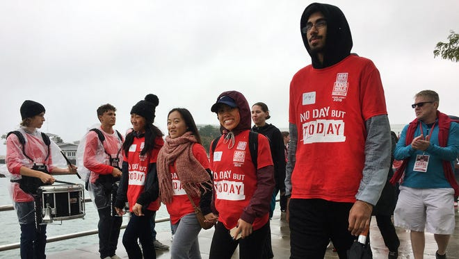 From left, Riverside University High School student council members Mary Lor, Alexus Lor, Lisa Lor and Sirtaj Grewal march along the waterfront during the walk portion of the AIDS Walk Wisconsin & 5K Run last year at  Maier Festival Park.