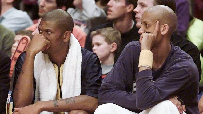 Reggie Miller (right) and Jalen Rose (left) both sitting on the bench.