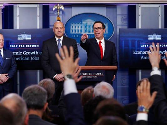 Steven Mnuchin, Gary Cohn, Sean Spicer