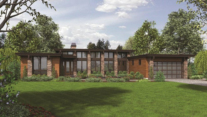 Glass and stone line both the front and back of this home for a light-filled layout with tremendous curb appeal.