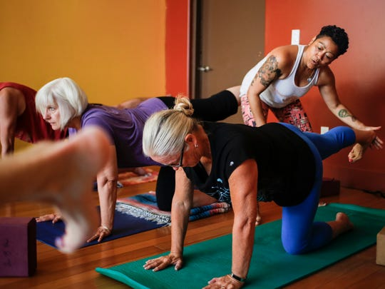 Belinda Thurston, founder of Just B Yoga & Tai Chi in REO Town during a yoga class Wednesday, August 9, 2017.   Thurston started the studio in 2010 as a donation-based studio serving underserved communities in the Lansing area.  [MATTHEW DAE SMITH | Lansing State Journal]