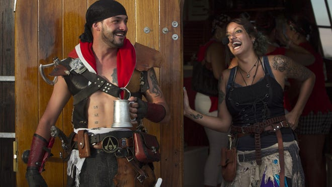 "Pirates Stephen ""Gabriel Grimm"" Sepulveda, left, and Ashley ""Evelyn Gray"" Mojica share a laugh on the Pieces of Eight Adults-Only Pirate Cruise in Fort Myers Beach. Cruises are Friday nights."