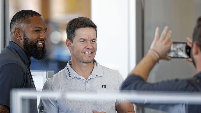 Mark Wahlberg posed for a photo with Justin Luckett last August at Mark Wahlberg Chevrolet on the West Side, Wahlberg's first auto dealership purchase in central Ohio.