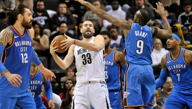 Memphis Grizzlies center Marc Gasol (33) controls the ball against Oklahoma City Thunder center Steven Adams (12), from left, guard Russell Westbrook, and forwards Paul George, Jerami Grant (9), and Carmelo Anthony (7) in the first half of an NBA basketball game Wednesday, Feb. 14, 2018, in Memphis, Tenn. (AP Photo/Brandon Dill)