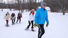 Snowshoers tackle winter at the Riveredge Nature Center in Newburg. It is one of a number of local spots good for snowshoeing.