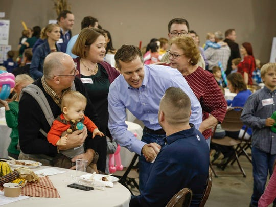 Missouri Gov. Eric Greitens meets with Iowans during Iowa Gov. Kim Reynolds' Harvest Festival at the Iowa State Fairgrounds in Des Moines on Saturday, Oct. 21, 2017.