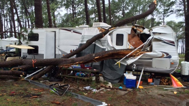 Trees crashed through at least one trailer at Cherrystone campground in Cape Charles, Va., where 3 people died July 24, 2014.