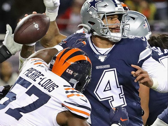 CHICAGO, ILLINOIS - DECEMBER 05: Dak Prescott #4 of the Dallas Cowboys is hit while throwing by Kevin Pierre-Louis #57 of the Chicago Bears at Soldier Field on December 05, 2019 in Chicago, Illinois. The Bears defeated the Cowboys 31-24. (Photo by Jonathan Daniel/Getty Images)
