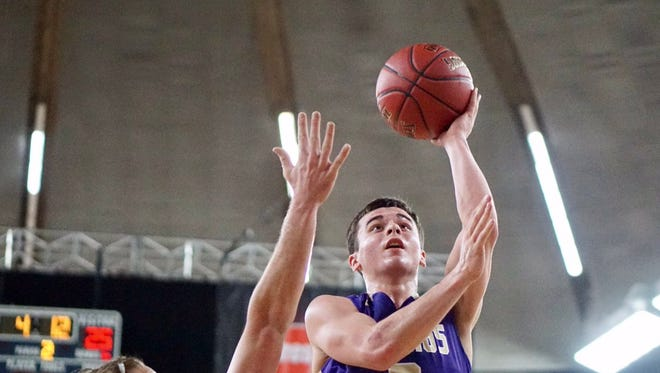 North Kitsap's Zac Olmsted heads to the rim for two points in the VIkings' win over Prosser on Friday at the Class 2A state tournament in Yakima.