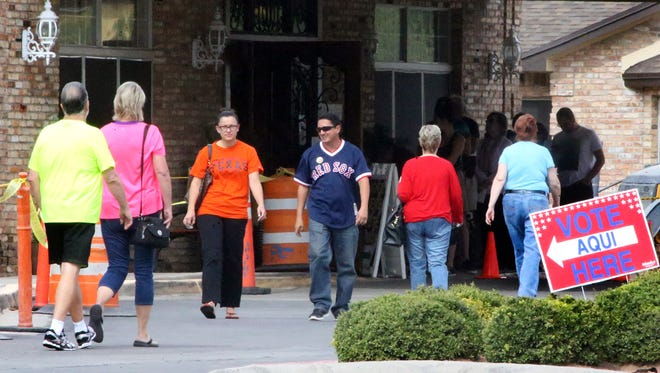 El Paso voters line up and leave the early polling station inside the Bartlett Assisted Living Center at 221 Bartlett Drive in West El Paso on Friday.