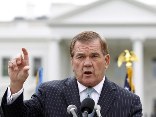 FILE - In this Oct. 22, 2011, file photo, former Secretary of Homeland Security Tom Ridge speaks to a crowd of hundreds protesting in front of the White House in Washington. A spokesman says Ridge is in critical condition after undergoing an emergency heart procedure at a hospital in Austin, Texas. (AP Photo/Jose Luis Magana, File)