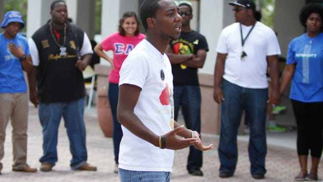 Antwon Lindsey speaks to a group gathered for a peace demonstration Wednesday, September 10 in Fort Myers to raise awareness of social issues and minorities on campus.