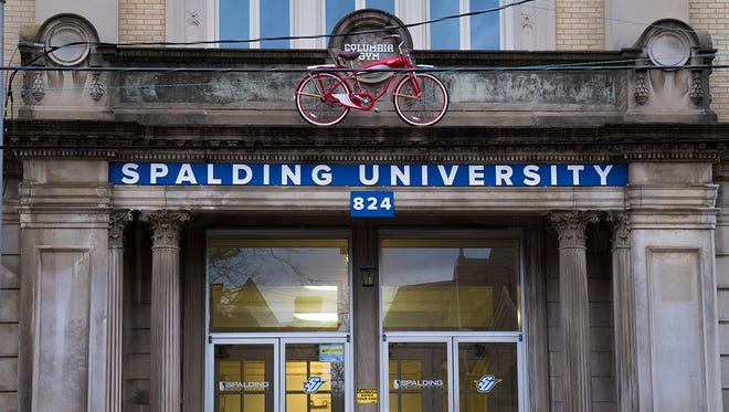 A red bicycle hangs over the entrance to the building that has been named by Spalding University as Columbia Gym in honor of boxing legend Muhammad Ali.