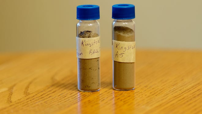 Vials hold samples of the coal ash collected from the Kingston coal ash spill site July 8, 2017.