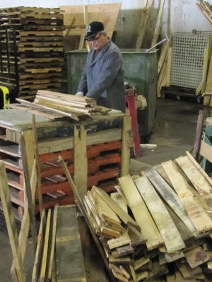 To avoid waste and expense, BrucePac repairs broken wood pallets on site.