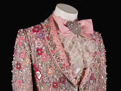 Perhaps the most ornate of Liberace���s costumes, this pink gabardine and silk suit is covered with satin appliques, pastel seed and bugle beads, crystals and pearls.