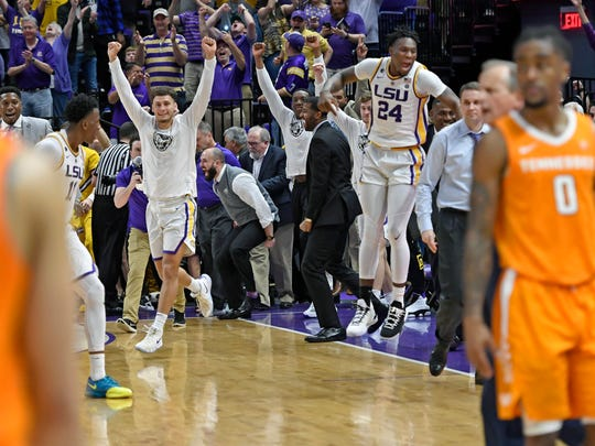 The LSU bench erupts after the Tigers defeated Tennessee