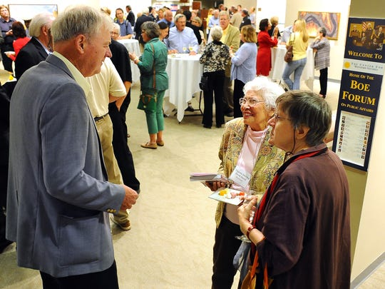 John Miller, an author from Brookings, talks with author Virginia Driving Hawk Sneve and Kathleen Norris, a poet and author, during a reception Thursday for the South Dakota Festival of Books at Augustana College.