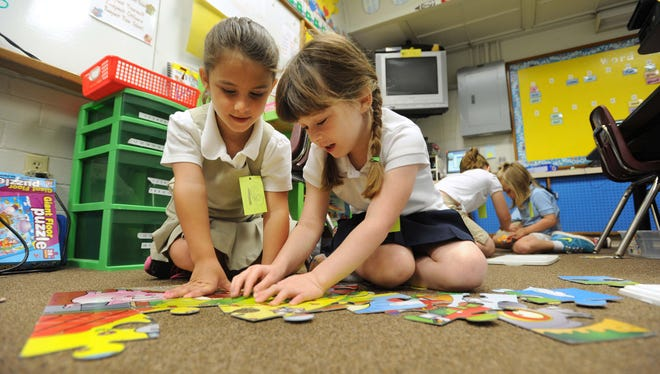 Alaina Osbon and Sophia Link work on a puzzle together in Melissa Conrad's kindergarten class at Shreve Island Elementary school in Shreveport, La., in June 2012.