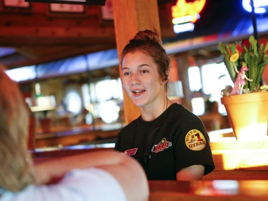 On a recent evening, Hannah Sinclair greeted guests at the Texas Roadhouse in Middletown.