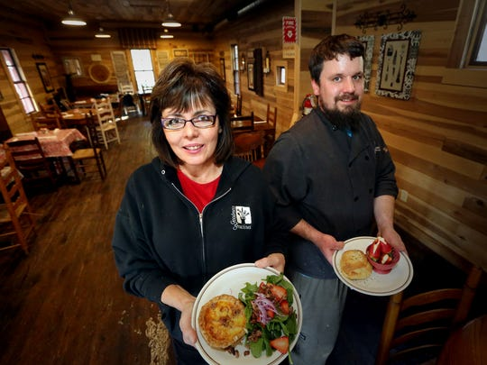 In this 2015 file photo, Karen Ford, left, holds quiche Lorraine with a strawberry spinach salad as her son, Eric Ford, holds a chicken puff pastry with a side of filled strawberries at Goodness Gracious at the Mill in Readyville. some of the signature dishes at Goodness Gracious at the Mill.
