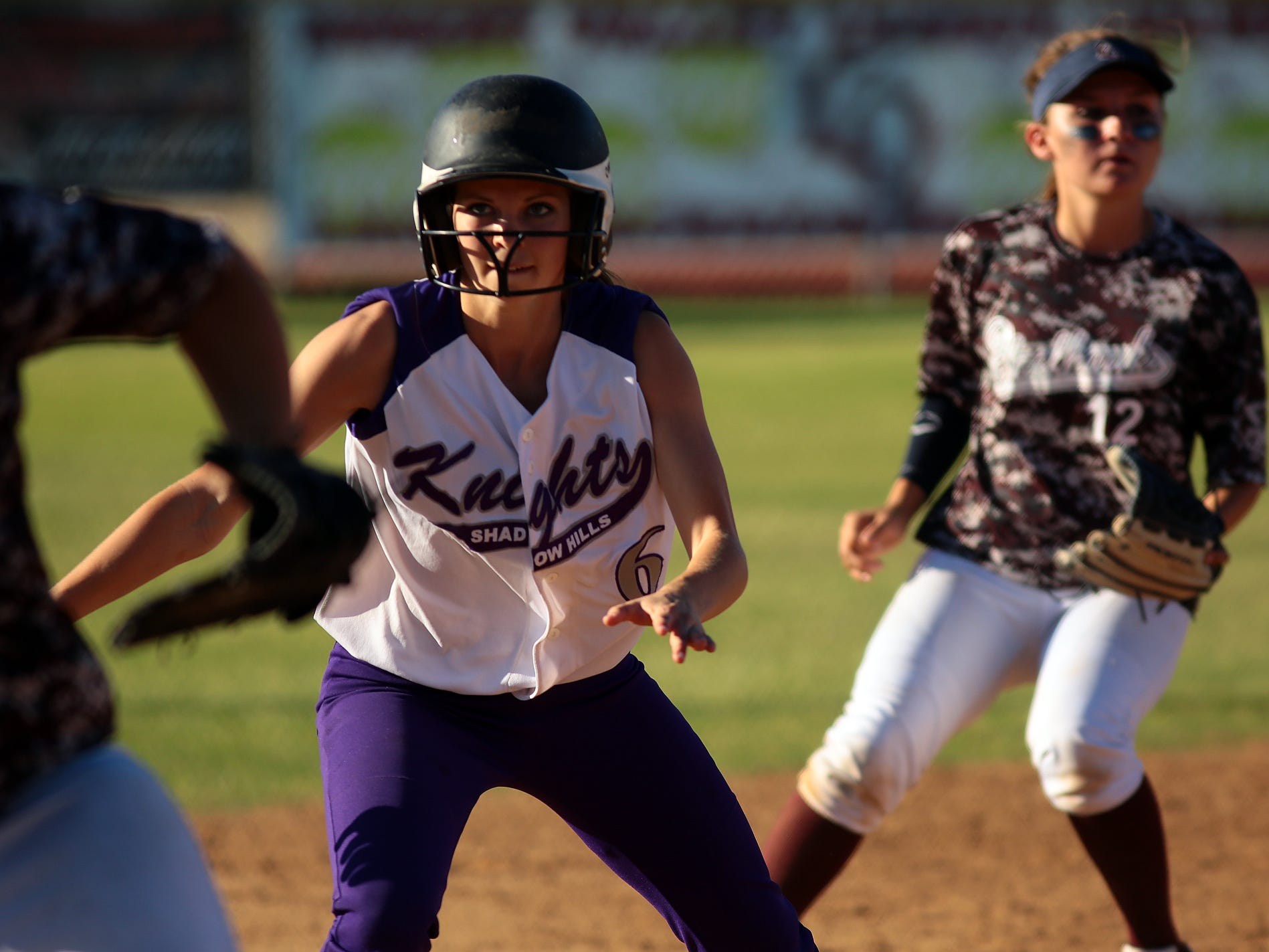 Brittany Dean of Shadow Hills (6) is caught in a pickle between second and third base Thursday afternoon during a game at La Quinta High School. Shadow Hills Knights played a double header against the Blackhawks, with La Quinta winning both games 7-5 and 4-1.