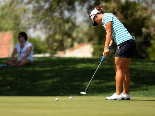 Lydia Ko takes a few moments by herself to hit practice putts on the back of the first green after her team putted out on Wednesday, April 1, 2015 during the ANA Inspiration pro-am at Mission Hills Country Club in Rancho Mirage, Calif.