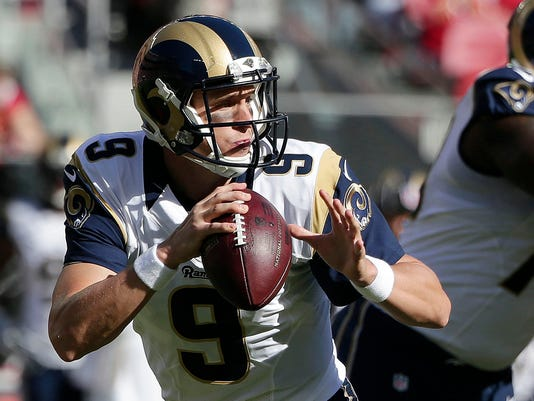 St. Louis Rams quarterback Austin Davis (9) passes against the San Francisco 49ers during the first quarter of an NFL football game in Santa Clara, Calif., Sunday, Nov. 2, 2014. (AP Photo/Marcio Jose Sanchez)