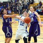 Cavegirls freshman guard Carsyn Boswell drives to the basket for a layup in the second quarter Tuesday.