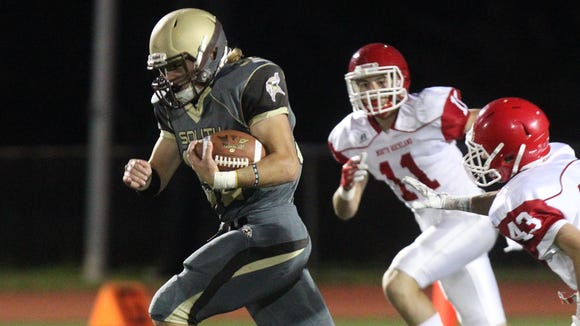 Clarkstown South's Sam Franco runs for the game's opening
