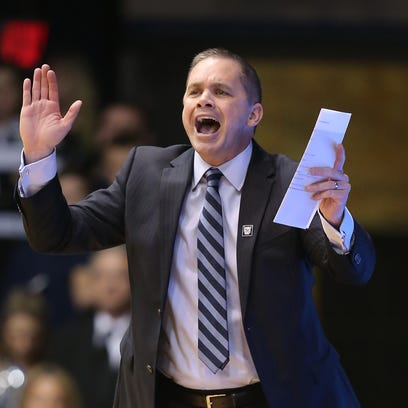Butler Bulldogs head coach Chris Holtmann calls in a play to his players in the first half of their game.