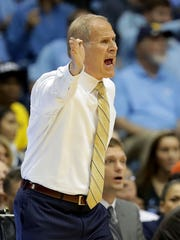 Michigan coach John Beilein reacts on the bench against