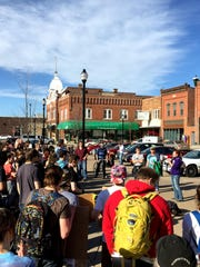 Students gather Thursday in downtown Stevens Point to protest Gov. Scott Walker's proposed cuts to the UW System.