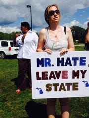 Julie Haefner, a history student at Central Michigan University, was one of a couple dozen protesters outside the Birch Run Expo Center, where Donald Trump was scheduled to begin speaking at about 7 p.m.