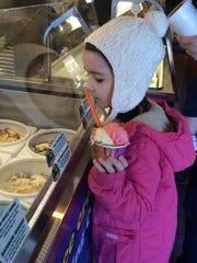 A child chooses an ice cream flavor at King Cone.