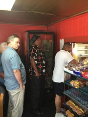 Standing in line to place your orders at Helen's whether to go or eat in.